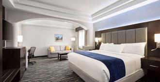 休斯敦荷比机场戴斯旅馆&套房酒店 - 休斯顿 - 睡房