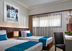 巴厘岛沙努尔天堂套房酒店 - 登巴萨 - 睡房
