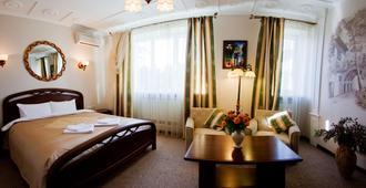 欧萨利亚酒店 - 基辅 - 睡房