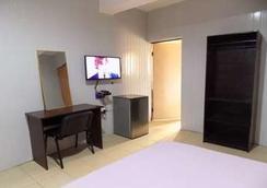 波时公寓酒店 - 拉戈 - 睡房