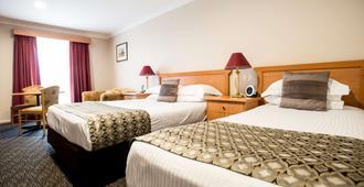 贝斯特韦斯特奥尔塞特拉普拉斯汽车旅馆 - 塔姆沃思 - 睡房