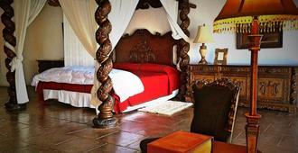 拉卡萨德洛斯苏诺斯酒店 - 安地瓜 - 睡房