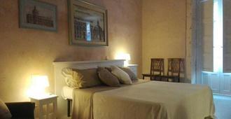 代达洛客房家庭旅馆 - 诺托 - 睡房