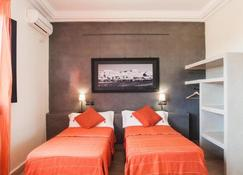 达查玛酒店 - 瓦尔扎扎特 - 睡房