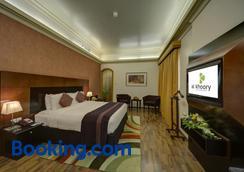 珊瑚奧酷瑞公寓酒店 - 迪拜 - 睡房