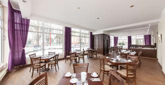 拉特斯奥兹莱比锡新奇公寓酒店 - 莱比锡 - 餐馆