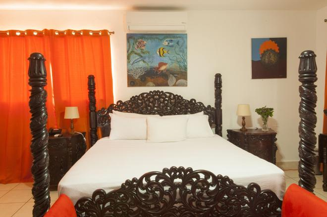 拉波萨达德尔阿康热尔住宿加早餐旅馆 - 馬拿瓜 - 睡房
