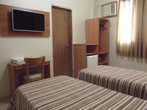 咕噜马尔酒店 - 瓜鲁雅 - 睡房