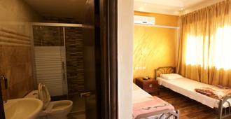 日出酒店 - 安曼 - 睡房