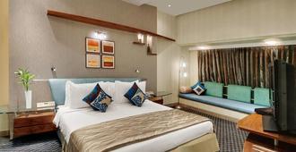 孟买科西诺大陆酒店 - 孟买 - 睡房