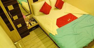 孟买新印度酒店 - 孟买 - 睡房