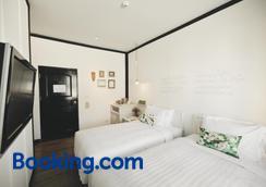 曼谷拉威坎拉亚酒店 - 曼谷 - 睡房