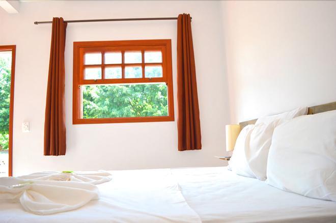 林多亚乡村酒店 - 阿瓜斯-迪林多亚 - 睡房