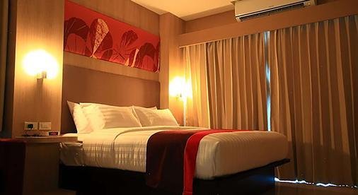 皇家武里南贝斯特韦斯特酒店 - 武里南 - 睡房