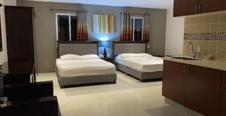 库拉索套房酒店 - 威廉斯塔德 - 睡房