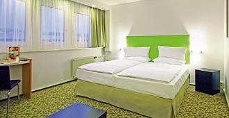 德勒斯登中心宜必思酒店 - 德累斯顿 - 睡房