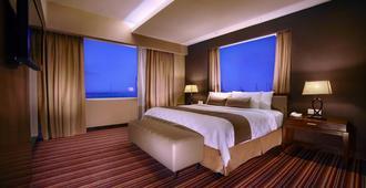 马卡萨阿斯顿酒店及会议中心 - 马卡萨 - 睡房