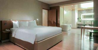 岘港汉江诺富特高级酒店 - 岘港 - 睡房