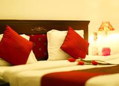 坎姆拉宫酒店 - 德拉敦 - 睡房