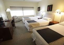 阿尔玛克鲁斯酒店和会议中心 - 圣地亚哥 - 睡房