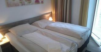 尼古拉特酒店(原尼古拉酒店) - 奥斯纳布吕克 - 睡房