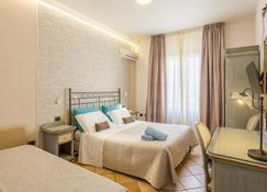 特里娜科里亚酒店 - 圣维托洛卡波 - 睡房