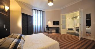 贝斯特韦斯特大陆坡市旅馆 - 波城 - 睡房