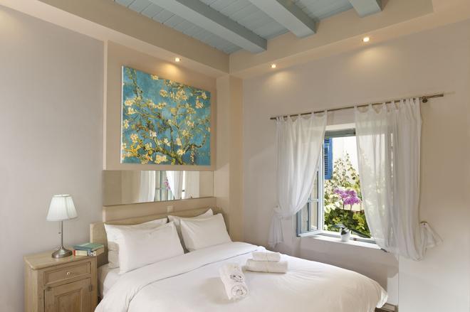 罗德卡萨昂提卡酒店 - 罗德镇 - 睡房