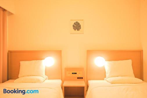 冲绳那霸微笑酒店 - 那霸 - 睡房