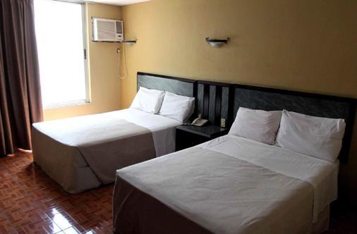 环球酒店 - 瓜达拉哈拉 - 睡房