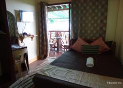 皇家天堂旅馆 - 塔比拉兰 - 睡房