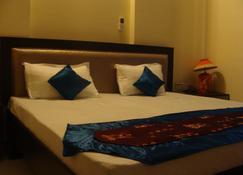 艾比楠丹大酒店 - 德拉敦 - 睡房