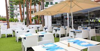 兰瑞达普拉亚博尼塔酒店 - 马斯帕洛马斯 - 餐馆