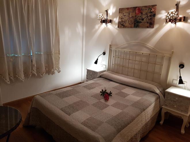 阿赞贝克卡德斯酒店 - 坎加斯-德奥尼斯 - 睡房