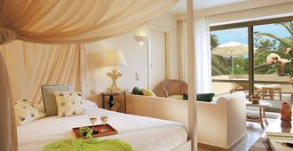 格雷科泰克雷塔皇庭酒店 - 罗希姆诺 - 睡房