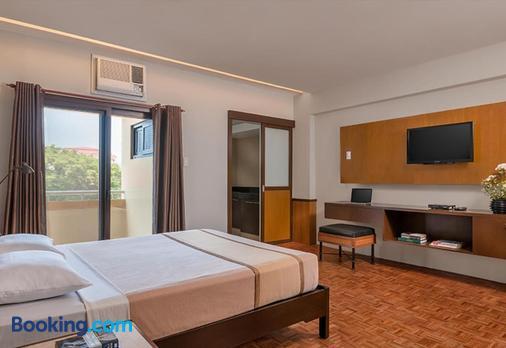 特洛皮卡纳套房酒店 - 马尼拉 - 睡房
