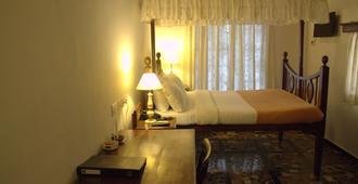 威尔康姆传统潘吉姆珀萨达酒店 - 帕纳吉 - 睡房