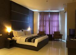 凱裡亞德飯店-莎多蘭格斯 - Tanah Grogot - 睡房