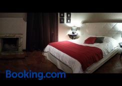 卡利坎图斯家庭旅馆 - 米兰 - 睡房