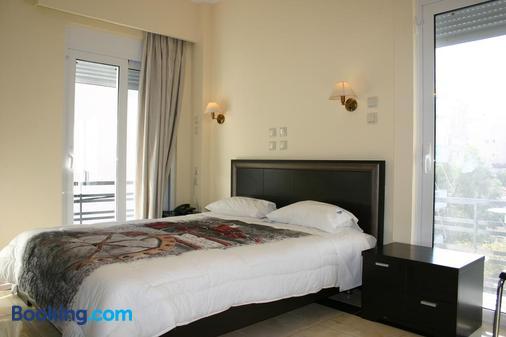 佩缇特帕拉斯酒店 - 路特奇 - 睡房