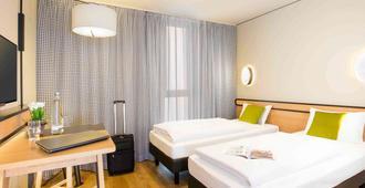 慕尼黑市奥林匹克公园休闲公寓式酒店 - 慕尼黑 - 睡房