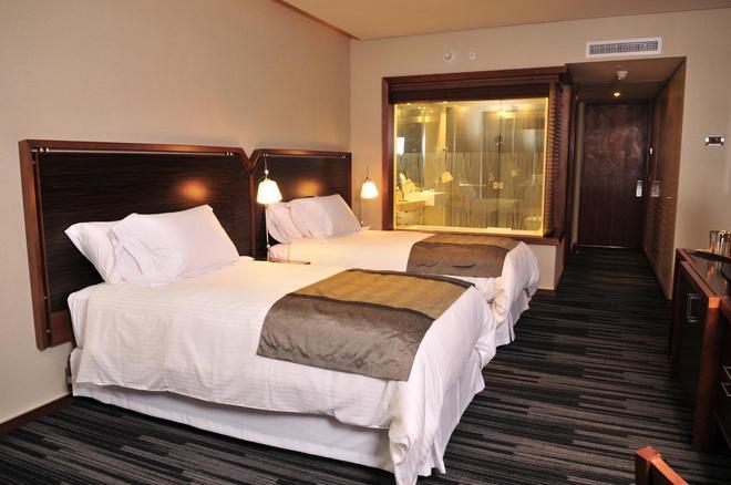 德尔艾斯托切梦之酒店 - 蓬塔阿雷纳斯 - 睡房