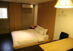 居尼宾精品酒店 - 首尔 - 睡房