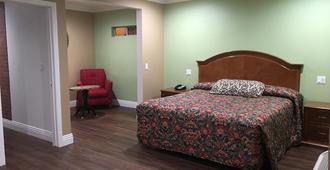 美国lax机场套房酒店 - 英格尔伍德 - 睡房