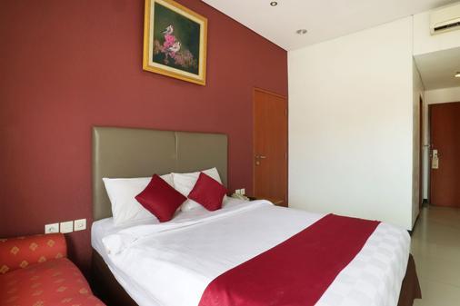 蓝色太平洋酒店 - 南雅加达 - 睡房