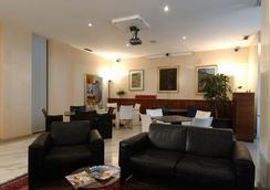 布里科斯里昂酒店 - 特伦托 - 睡房
