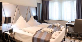 法兰克福美居凯瑟市中心酒店 - 法兰克福 - 睡房