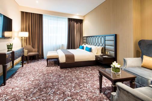 多哈金色郁金香酒店 - 多哈 - 睡房