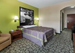 速8德克萨斯州休斯敦洲际酒店 - 亨博尔 - 睡房