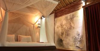 萨普里迪水疗画廊度假酒店 - 乌布 - 睡房